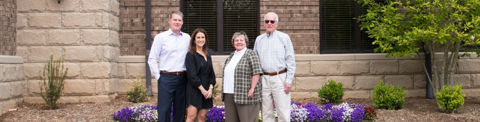The Stewart Family, left-to-right: Andrew Stewart, Tina Stewart, Karen Stewart, Les Stewart in front of the Stewart Engineers Headquarters